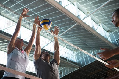Low angle view of players practicing volleyball