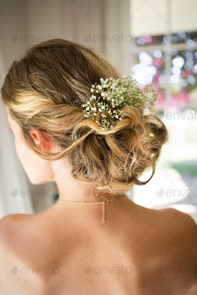 Close up of bride blond hair with flowers