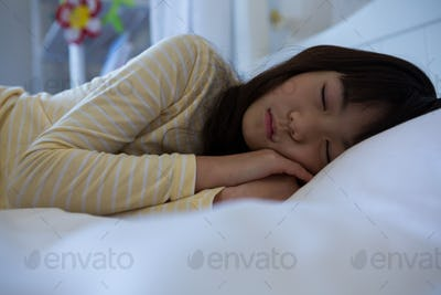 Girl sleeping in bedroom