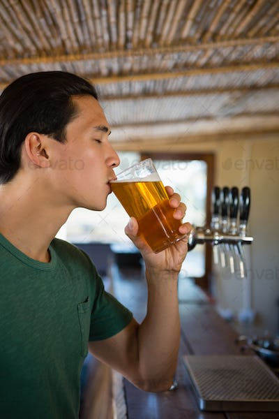 Young man having drinking beer