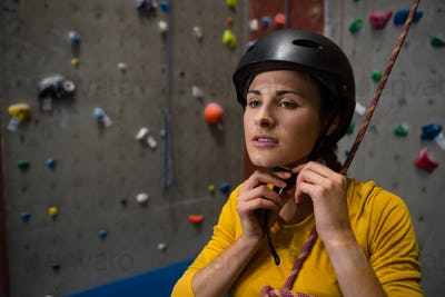Confident athlete wearing sports helmet in health club