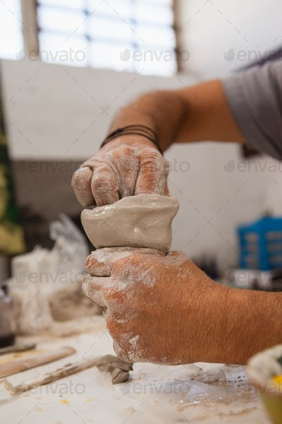 Potter molding clay