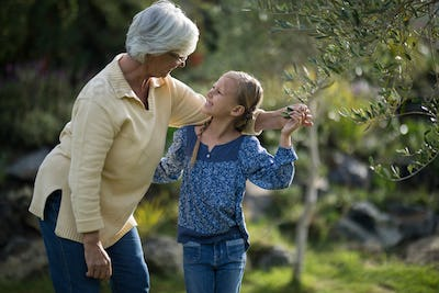 Smiling granddaughter and grandmother interacting with each other