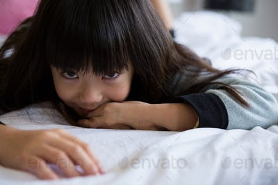 Portrait of girl relaxing on bed