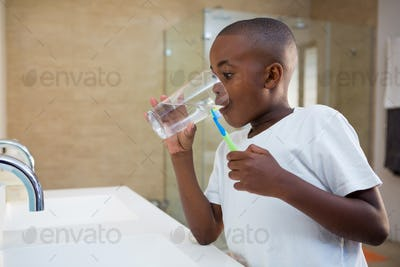 Boy drinking water from glass