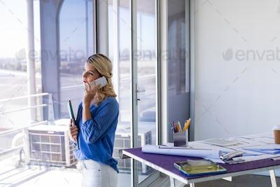 Female architect talking on mobile phone