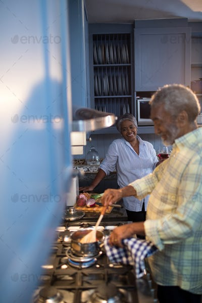 Woman looking at man preparing food