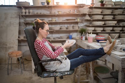 Woman sitting on chair checking bowl