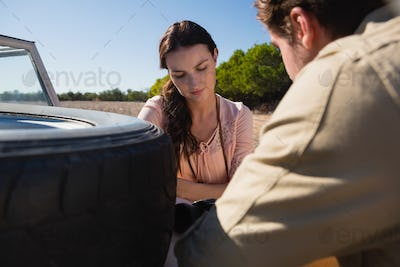 Woman with man by off road vehicle