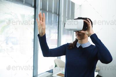 Female executive using virtual headset