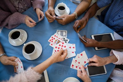 Overhead view of senior people playing cards