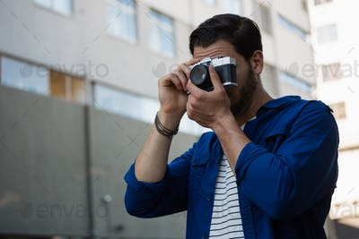 Young man photographing through camera