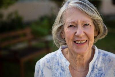 Portrait of happy senior woman at park