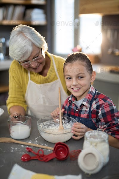 Granddaughter mixing flour in a bowl