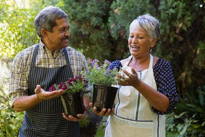 Senior couple interacting with each other in garden
