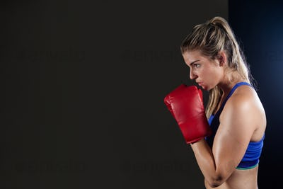 Woman practicing boxing in fitness studio