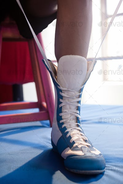 Boxer wearing shoes in boxing ring