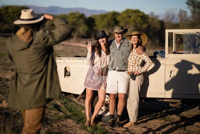 Man taking a picture of his friends during safari vacation