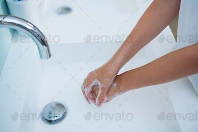 High angle view of girl washing hands