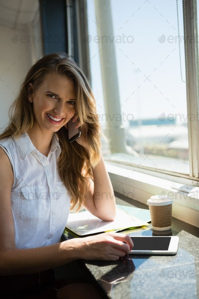Portrait of smiling businesswoman talking on mobile phone