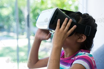 Side view of girl wearing virtual reality simulator