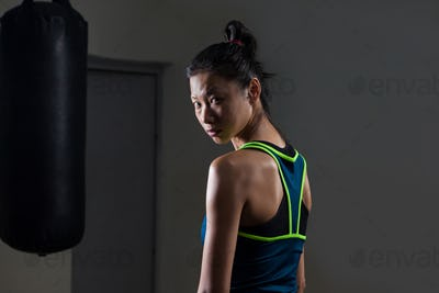 Determined woman standing in fitness studio