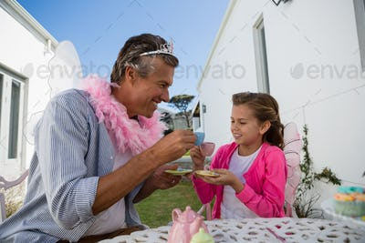 Father and daughter in fairy costume having fun