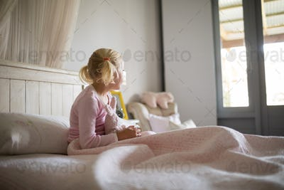 Girl relaxing on bed in the bedroom at home