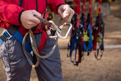 Close-up of hiker man adjusting his harness