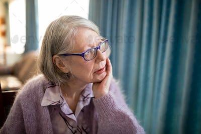 Thoughtful senior woman looking away