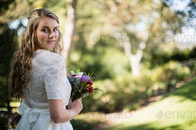 Portrait of beautiful bride holding bouquet