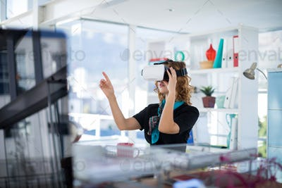 Female designer using virtual reality headset