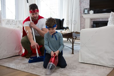 Father and son pretending to be superhero