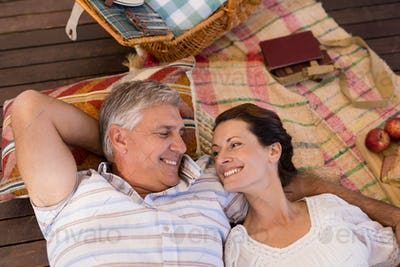 Happy couple relaxing in cottage