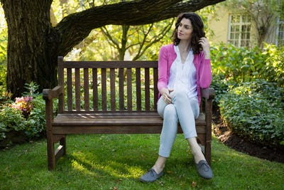Thoughtful woman sitting on park bench