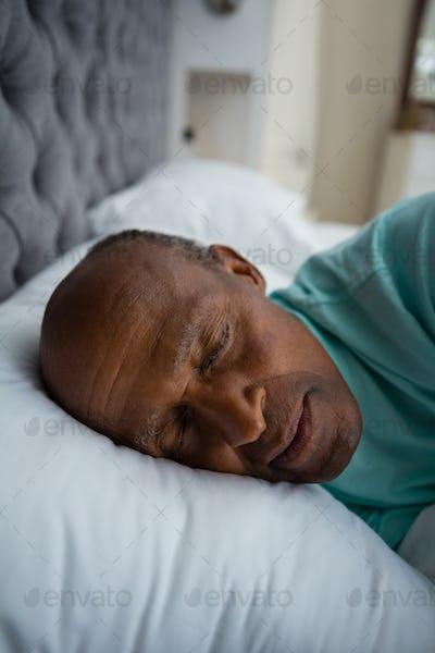 Close up of senior man sleeping on bed