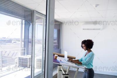 Female architect working over laptop