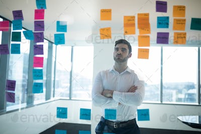 Male executive reading sticky note