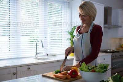 Beautiful woman chopping vegetables
