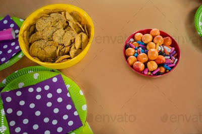 Confectioneries and decorated plates on a table