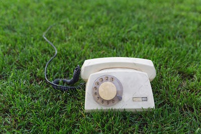 Old retro phone on the grass