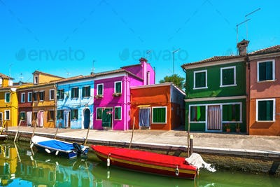 Venice landmark, Burano island canal, colorful houses and boats,