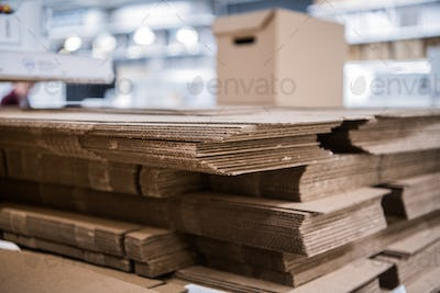 many non-assembled cardboard parcel boxes on stock close up