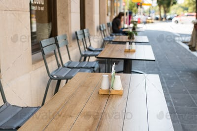 Typical summer outdoor cafe. Tables and chairs summer cafe, restaurant on streets of city in