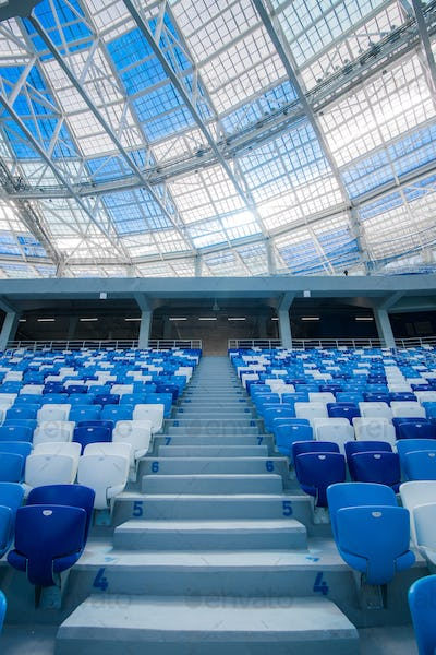 Cement stairs and blue seats inside football stadium