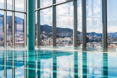 Contemporary interior with swimming pool and city view. Great water surface