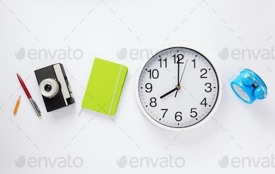 wall clock and notebook with camera