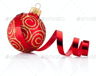 Red Christmas decoration bauble and curling paper Isolated on wh