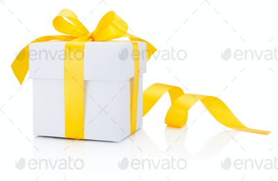 White gift box tied yellow ribbon bow Isolated on white backgrou