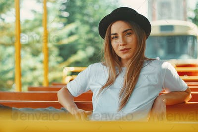 Young woman with hat on a city tour